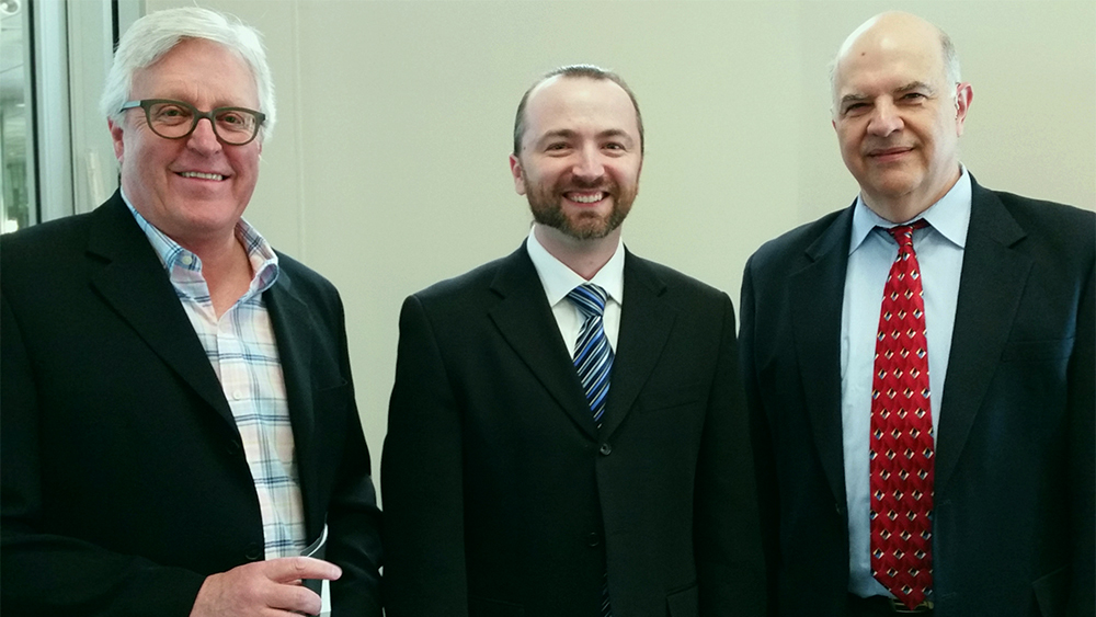 Rheal Gingras, Regional Manager at Domtar, Dr. Joe Webb with Slava Spel