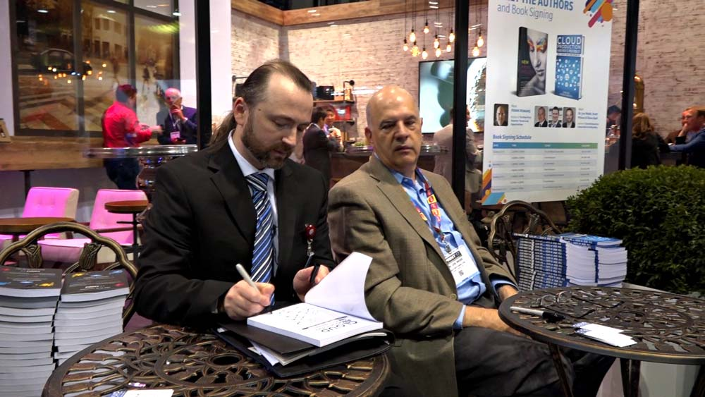 Slava Apel and Dr. Joe Webb signing their new book Cloud Production